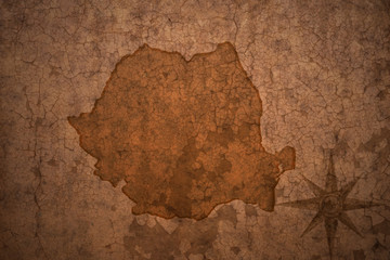 romania map on vintage crack paper background