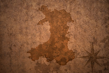 wales map on vintage crack paper background