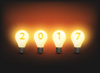 Happy new 2017 business year, with light bulb and number 2017