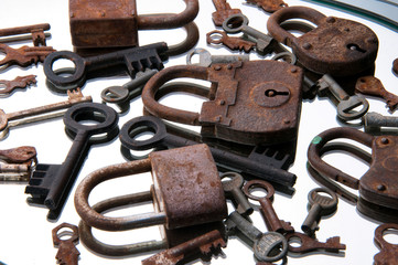 Old rusty padlocks and keys on white background. Mirror