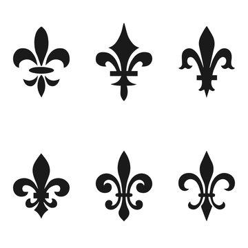 Collection of fleur de lis symbols, black silhouettes - heraldic symbols. Vector Illustration. Medieval signs. Glowing french fleur de lis royal lily. Elegant decoration symbols.