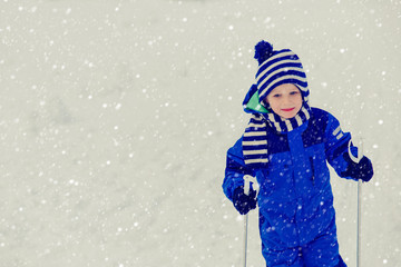 little boy ski in winter