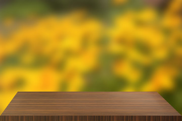 image of wooden table in front of abstract blurred background