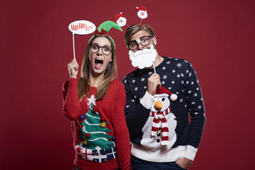 Couple with funny christmas masks.