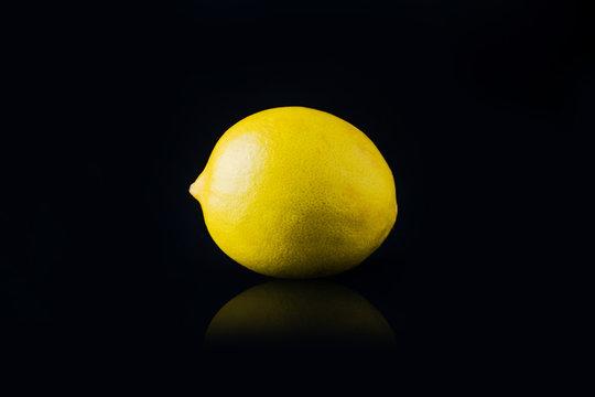fresh lemon fruit on the black background