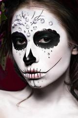 Woman in Halloween makeup - mexican Santa Muerte mask. Photos shot in studio