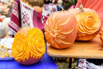 Big orange flower carved pumpkins, close up, traditional ornament carpet in Moldova