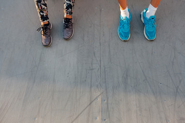 Women's and men's legs wearing sports shoes