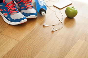 Sport shoes with energy drink and headphones