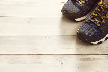 Sport shoes on wooden background
