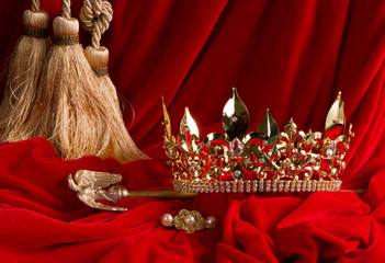 Crown and scepter on red velvet