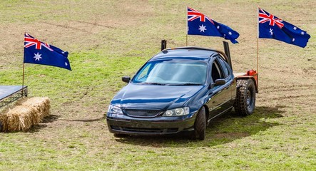Utility vehicle with three Australian flags and the Royal Melbourne Show