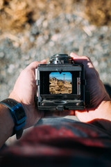 Landscape through the viewfinder of an old camera