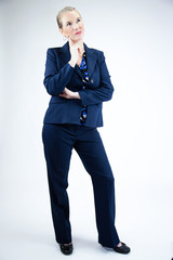 Business Woman With Hand On Chin Looking Up