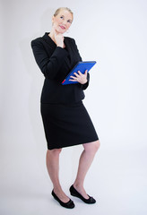 Business Woman Holding Tablet w/Index Finger to Chin