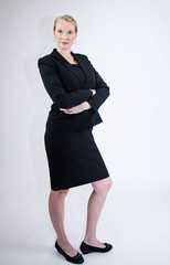 Business Woman In Business Dress with Hands Folded