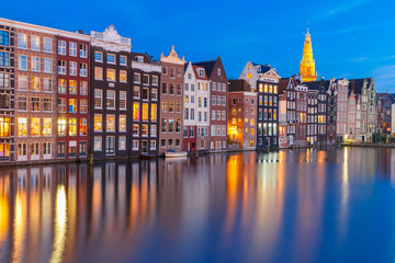 Printed kitchen splashbacks Amsterdam Amsterdam canal with Beautiful typical Dutch dancing houses and Oude Kerk church during twilight blue hour, Holland, Netherlands