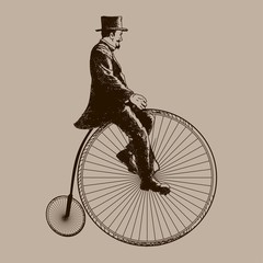 A Man Riding Old Bicycle