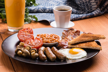 rustic full english breakfast on black plate