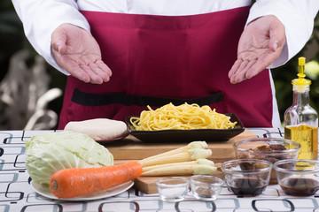 Chef present ingredient of stir fry vegetarian Noodle