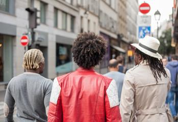 group people walk on street in Paris
