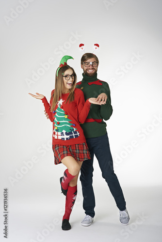 Funny Couple Wearing Weird Christmas Sweaters