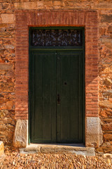 Antique wooden door in a stone house