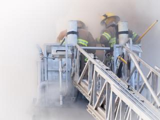Firefighters on platform in heavy smoke