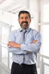 Senior Hispanic Businessman Smiling