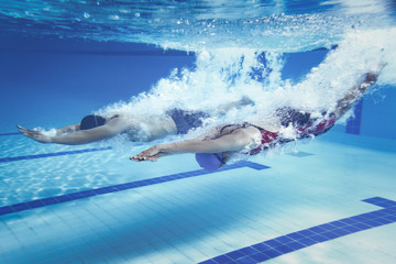 swimmer Jump from platform jumping A swimming pool.Underwater ph