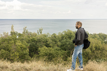 Beautiful sea landscape. A man photographs the sea and the sky.