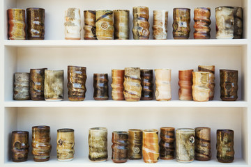 Ceramic jars arranged in rows on shelves