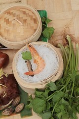 Baked shrimp with vermicelli and celery leaves.