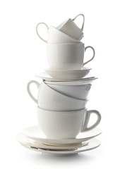 stack of white cups and plates