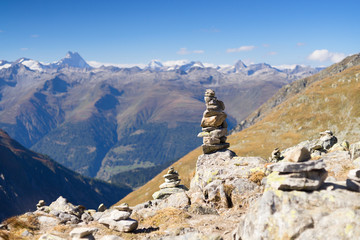 Stone cairn at the Nuffenen Pass in Swiss Alps. Selective focus.