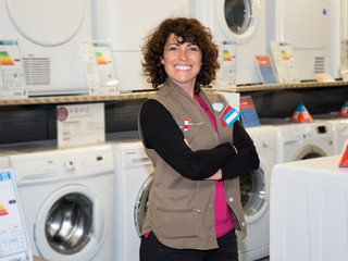 Female Seller helping customer with choosing washing machine
