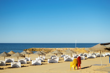 Beach ready for tourists. Golden sand with blue sky outdoors nature background
