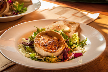 Czech Specialities: Grilled goat cheese with honey and chopped salad