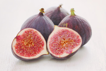 figs on white wooden background