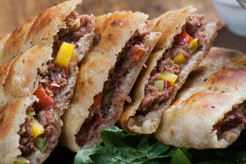 An Egyptian food  hawawshi is a  classic of spiced meat baked in  bread served with tahina
