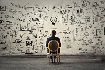 Fototapeta Businessman trying to solve problems