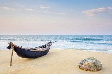 Bamboo basket fishing boat on the beach at sunset, Thuan An, Vietnam