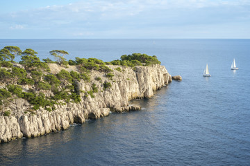 Sailboats passing the entrance of Calanque de Port-Pin