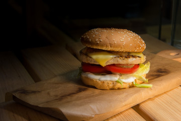 fast food on wooden table with contrast light