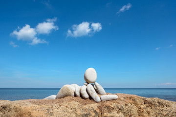 Figurine on the coast
