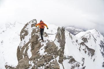 A man climbing Lizard Head Peak, Telluride, Colorado.