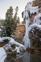A woman ice climbing near Ouray, Colorado.