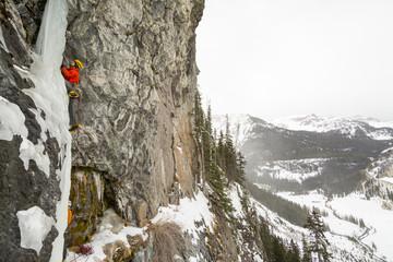 A man and woman ice climbing near Ouray, Colorado.
