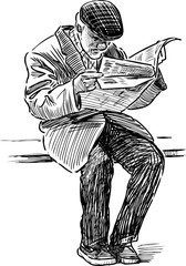 old man reads a newspaper on the park bench