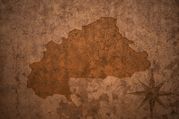 burkina faso map on a old vintage crack paper background